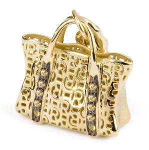 The popularity of charms continues unabated. Shown here: a gold and gemstone handbag charm by Rosato.