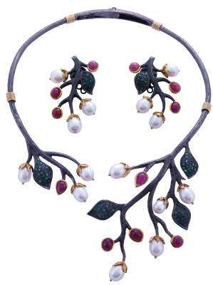 Gemstone, pearl, and silver earrings and necklace by Dhevan Dara.