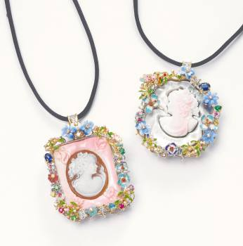 Santagostino featured cameo pendants framed by the brand's signature look of enamel, gold, and gemstones.