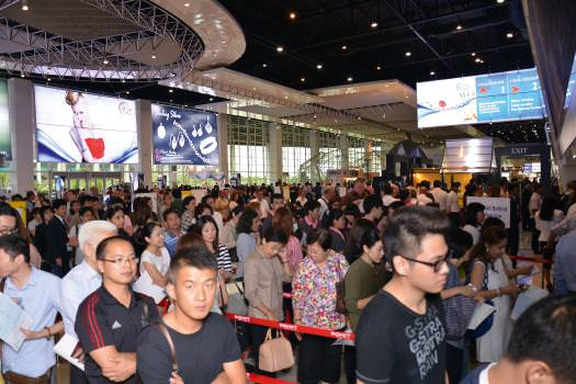 The crowds wait to enter the Bangkok Gem & Jewelry fair on the first day.